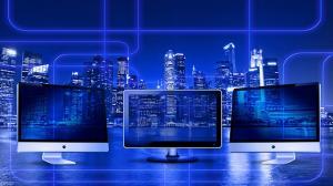 Website is interactive brochure - 3 monitors in front of skyline
