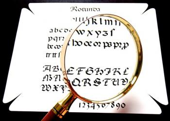 Magnifying glass with unreadable letters